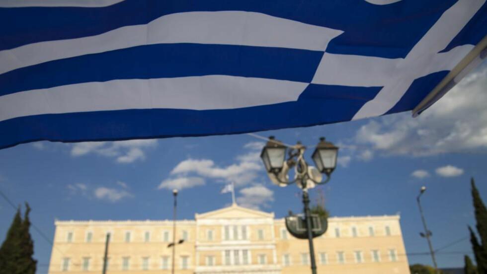 IKKE MER IGJEN: I dag, tirsdag 30. juni, vil Hellas for første gang unnlate en frist for å nedbetale gjelden sin til verdens valutafond IMF. Uten en ny avtale mellom Hellas og dets kreditorer har landet rett og slett ikke penger til å betale mer. Foto: NTB Scanpix