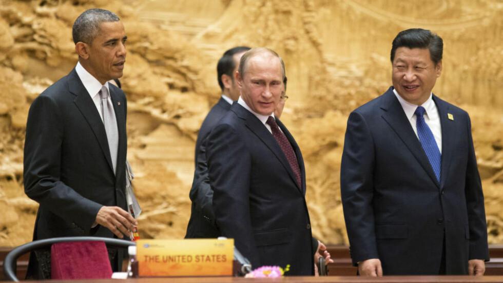 MEKTIG TROIKA: Denne uka møtes Obama, Xi og Putin to ganger. De møttes første gang i Beijing mandag og tirsdag, og for andre gang til G-20 møtet i Brisbane i Australia i dag og i morgen. Foto: Reuters /NTB Scanpix