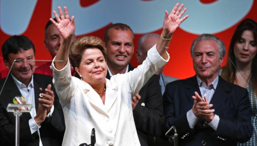 VALGVINNEREN:  Brasils president Dilma Rousseff ble gjenvalgt sist søndag etter en nervepirrende innspurt. Landet er nesten delt på midten; seieren var knappest mulig. Foto: AFP / NTB Scanpix