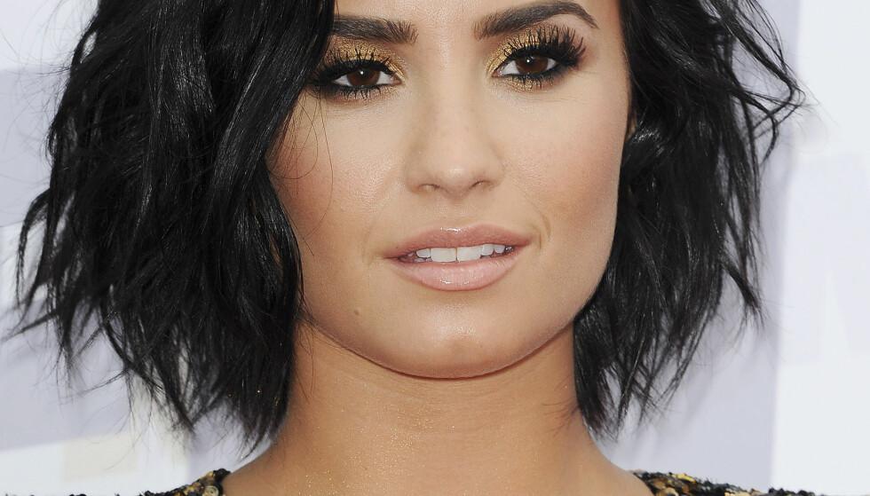 UT MOT FAN: Sangstjerna Demi Lovato så seg ikke fornøyd med måten hun ble framstilt på av en kunstnerisk fan. Nå slår kunstneren tilbake. Foto: Adhemar Sburlati/Broadimage, NTB scanpix