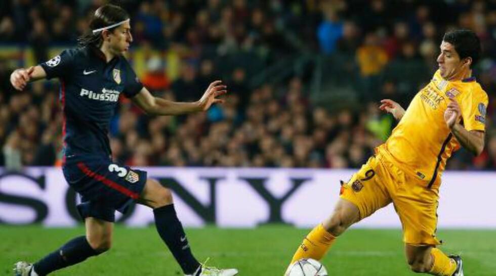 AMPERT: Filipe Luis har ikke et godt forhold til Luis Suares og Barcelona. Foto: AFP PHOTO / PAU BARRENA