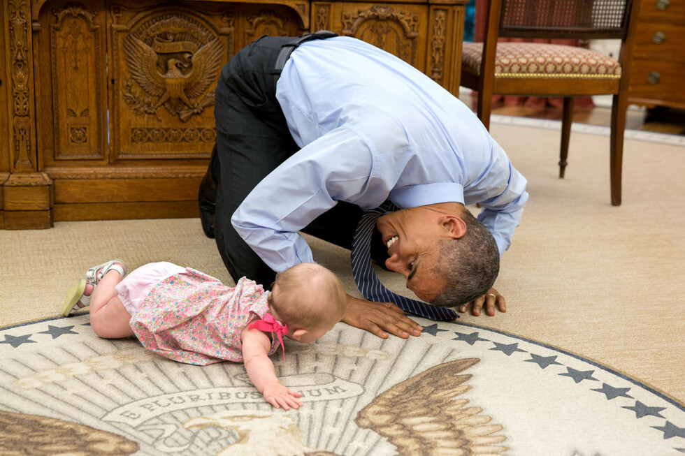 "June 4, 2015 - Washington, DC, United States: ""At the President's insistence, Deputy National Security Advisor Ben Rhodes brought his daughter Ella by for a visit. As she was crawling around the Oval Office, the President got down on his hands and knees to look her in the eye."" (Pete Souza/The White House/Polaris)   This official White House photograph is being made available only for publication by news organizations and/or for personal use printing by the subject(s) of the photograph. The photograph may not be manipulated in any way and may not be used in commercial or political materials, advertisements, emails, products, promotions that in any way suggests approval or endorsement of the President, the First Family, or the White House."