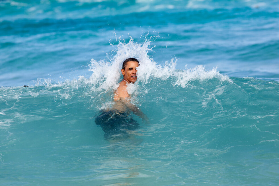 "TOPSHOTS In this image obtained January 3, 2012 and released by The White House, January 1, 2013 shows US President Barack Obama as he celebrates the New Year swimming in the ocean in his native state of Hawaii,  on his annual Christmas vacation with family and friends, at Pyramid Rock Beach in Kaneohe Bay. This official White House photograph is being made available only for publication by news organizations and/or for personal use printing by the subject(s) of the photograph. The photograph may not be manipulated in any way and may not be used in commercial or political materials, advertisements, emails, products, promotions that in any way suggests approval or endorsement of the President, the First Family, or the White House.= RESTRICTED TO EDITORIAL USE - MANDATORY CREDIT ""AFP PHOTO / The White House / Pete Souza"" - NO MARKETING NO ADVERTISING CAMPAIGNS - DISTRIBUTED AS A SERVICE TO CLIENTS ="