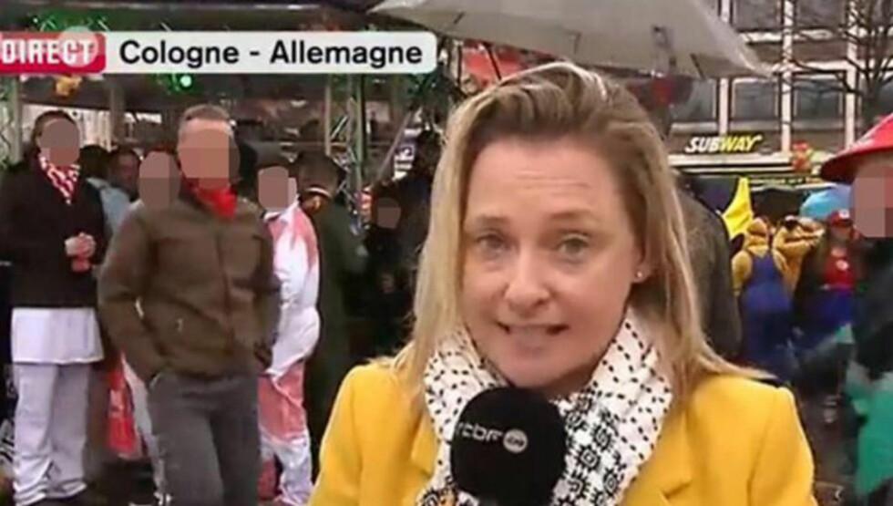 BLE BEFØLT: Da den belgiske journalisten Esmeralda Labye rapporterte live på tv fra karnevalet i Køln i går, fikk hun plutselig ei hånd plassert på brystet. Skjermdump: RTBF