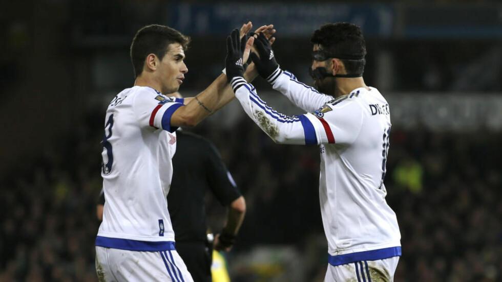 VANT IGJEN: Chelsea under Guus Hiddink hadde ingen problemer med å slå Alexander Tetteys Norwich 2-1 i tirsdagens kamp i Premier League. Foto: Reuters / Peter Cziborra / NTB Scanpix