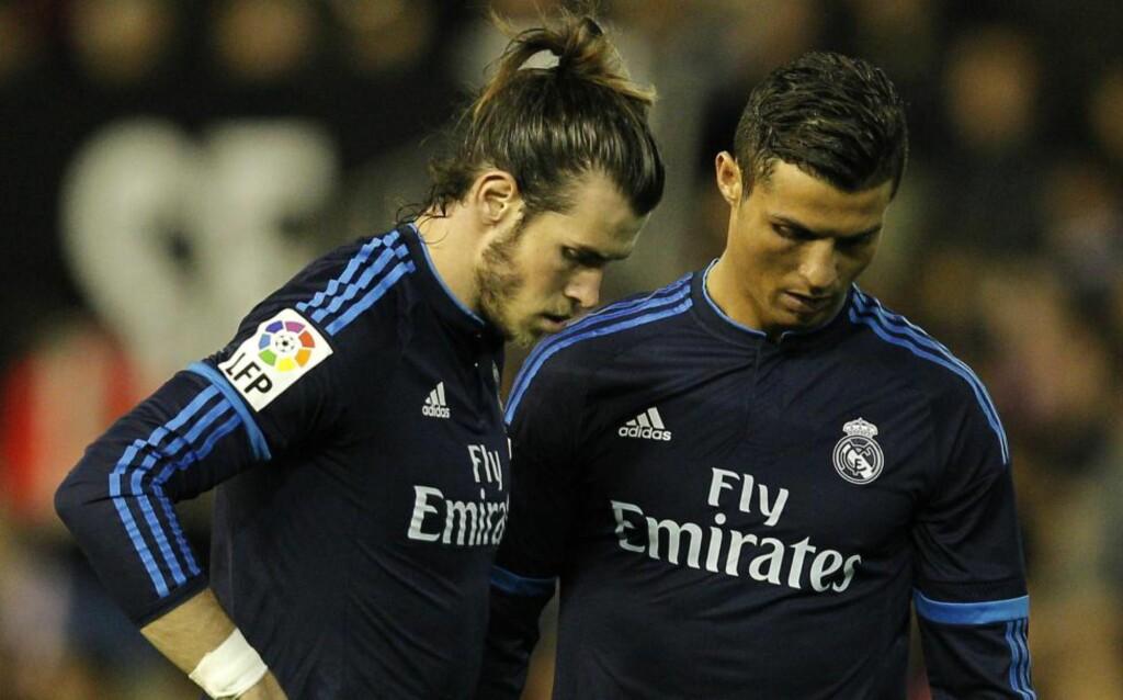 MISTET TO POENG: Real Madrid-spillerne Gareth Bale og Cristiano Ronaldo er nok ikke fornøyd med ett poeng i kveld. Foto: AFP PHOTO/ JOSE JORDAN/NTB Scanpix