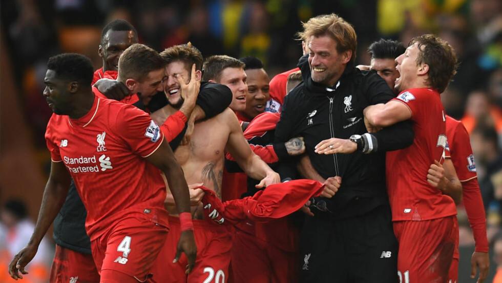 FORNØYDE: Liverpool scoret fem minutter på overtid og tok seieren i oppgjøret mot Norwich. Foto: Jon Buckle/PA via AP