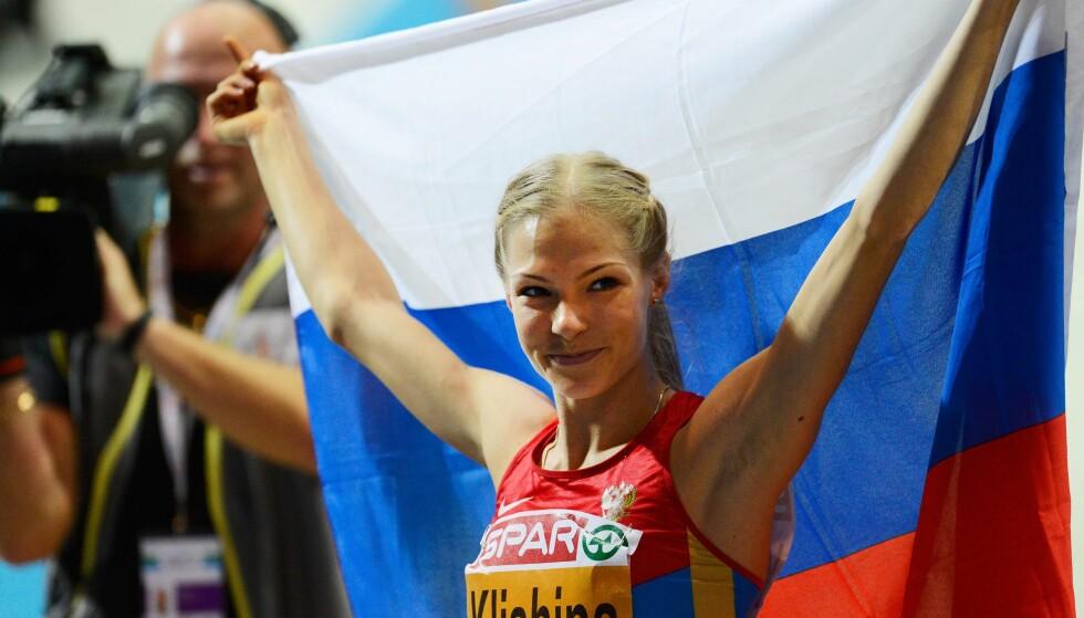 UT MED RUSSLAND: I årevis har lengehopperen Darja Klisjina frontet Russlands kamp for å få være med i internasjonal idrett etter Sotsji-svindelen. Nå er kampen tapt. Russland er utestengt i fire år, men straffen kommer med flere unntak. FOTO: AFP/Jonathan Nackstrand.