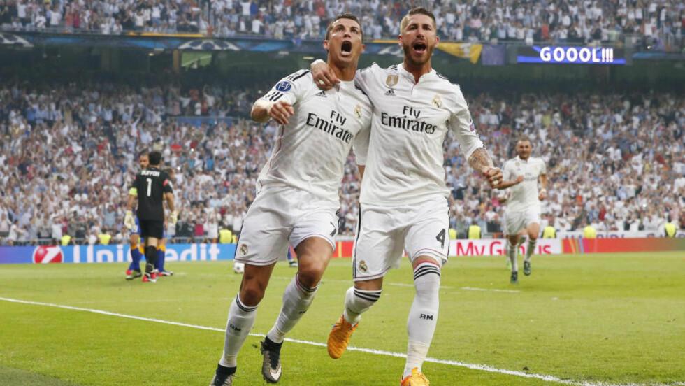 GODE VENNER: Sergio Ramos ønsker seg vekk fra Real Madrid. Da Cristiano Ronaldo ble konfrontert med dette i et tv-intervju forleden, ble intervjuet avbrutt. Her er de to fra Champions League tidligere i år. Foto: Reuters / Juan Medina