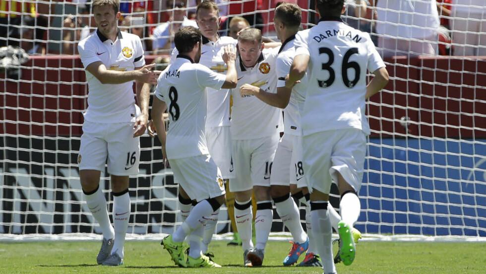 SCORET: Manchester Uniteds Wayne Rooney fikset 1-0-målet mot Barcelona. Foto: AP Photo/Jeff Chiu