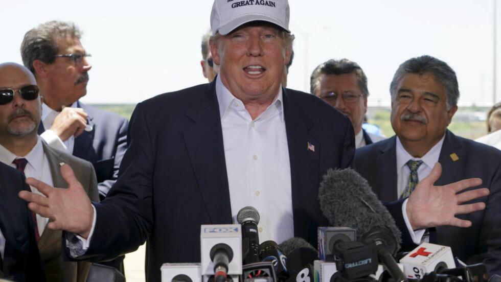 LEDER: Milliardæren Donald Trump har fått et stort forsprang i den republikanske nominasjonskampen til presidentvalget i 2016, ifølge en meningsmåling utført for Reuters. Foto: REUTERS/Rick Wilking/NTB Scanpix