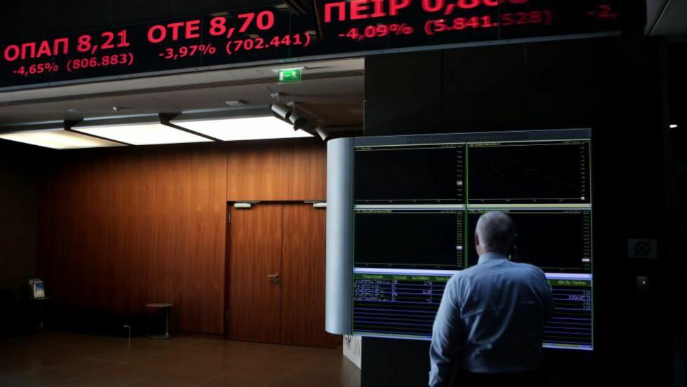 ÅPNER IGJEN: Aten-børsen har ikke vært åpen siden 26. juni. Bankene ble også stengt, og det ble innført kapitalkontroll da det greske kaoset var et faktum. Foto: AFP PHOTO / Angelos Tzortzinis