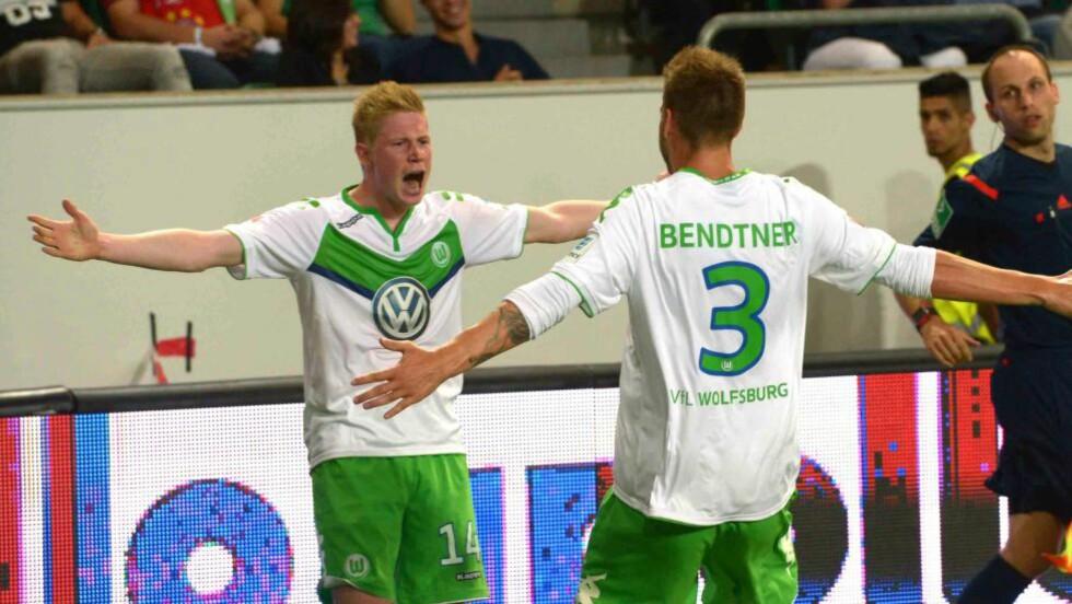 JUBEL:  Kevin De Bruyne  jubler sammen med Nicklas Bendtner. Foto: NTB Scanpix