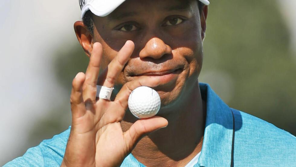 RASTE NEDOVER PÅ LISTENE:  Tiger Woods fikk det ikke til å stemme søndag. Foto: AP Photo/Steve Helber/NTB Scanpix.