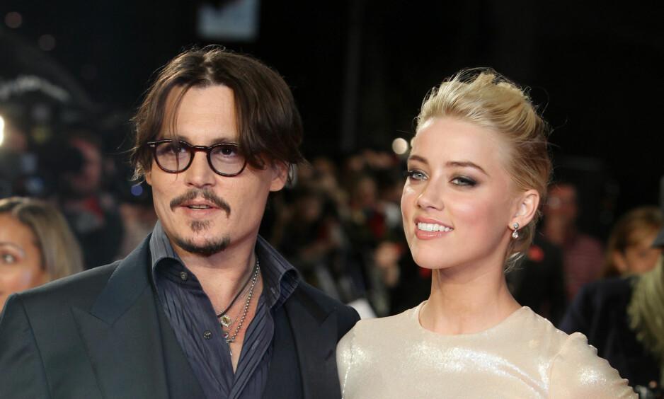 <strong>ENDELIG FERDIG:</strong> Tirsdag kveld ble det kjent at saken mellom Amber Heard og Johnny Depp nå er avsluttet. FOTO: AP / NTB Scanpix