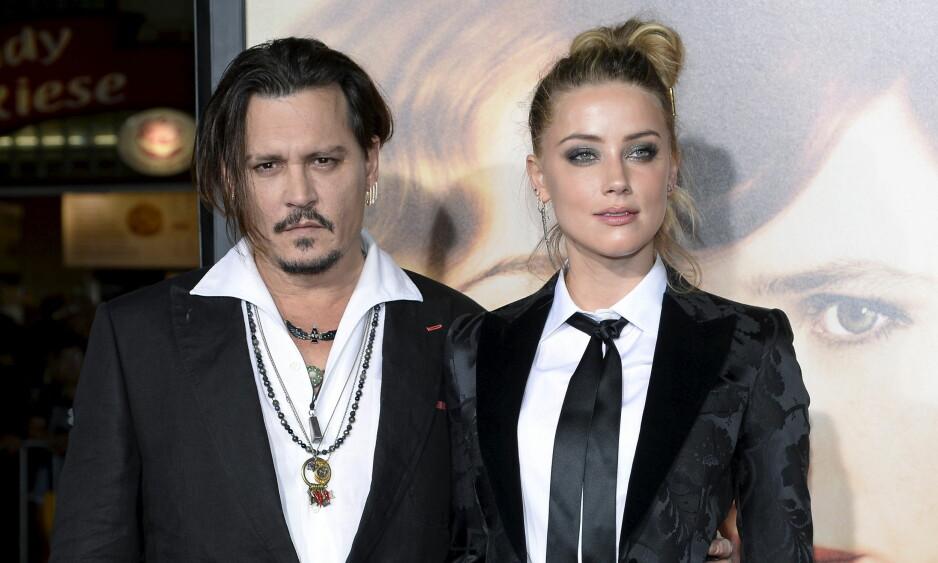 <strong>TRUBULENT SLUTT:</strong> Ekteskapet mellom Hollywood-stjernene Johnny Depp og Amber Heard fikk en turbulent slutt, som ble mye omtalt i media. Partene ble enige om et forlik tirsdag. Foto: REUTERS/Kevork Djansezian, NTB scanpix