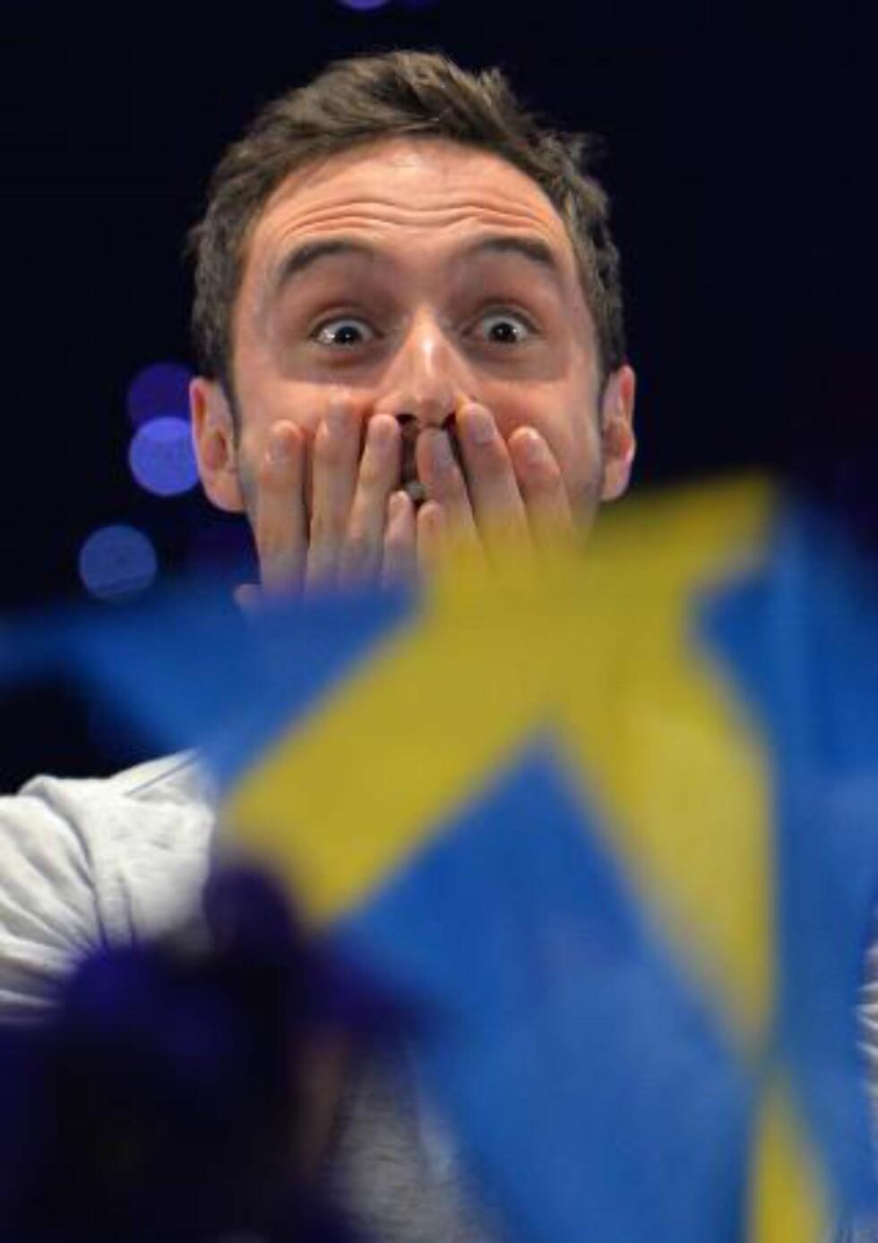 VANT:  Det var lenge en jevn finale mellom Sverige og Russland. Til tross for favorittstempelet turte ikke Måns Zelmerlöw slippe jubelen løs før seieren var et faktum. Foto: NTB/Scanpix