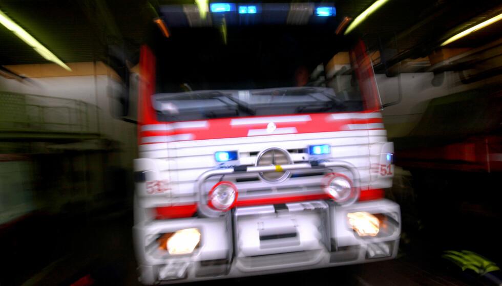 RYKKET UT: Brannvesenet måtte rykke ut til fem branner natt til torsdag. Fire av dem er i samme gate og fikk brannvesenet til å se rødt.. Foto: Heiko Junge / SCANPIX