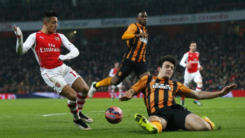 AVGJORDE KAMPEN: Selv om Arsenal ikke stilte med sin beste ellever, var blant andre en stjerne som Alexis Sanchez i aksjon på Emirates. REUTERS/Suzanne Plunkett