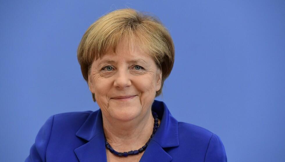 I SAMMENHENG: Ingrid Brekke har satt historien om Angela Merkel i en politisk sammenheng. Her på en pressekonferanse i Berlin i juli. Foto: NTB SCANPIX