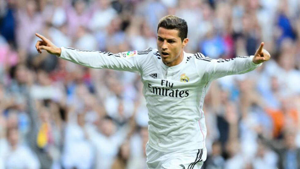 SLÅR REKORDER: Cristiano Ronaldo kan tangere Rauls rekord som Champions Leagues mestscorende gjennom tidene dersom han scorer mot Liverpool tirsdag. Foto: AFP PHOTO / DANI POZO