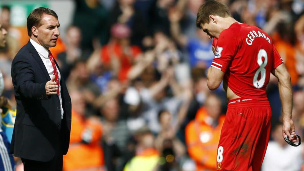 TRENGER HVILE: Liverpools kaptein Steven Gerrard må hvile enten mot Chelsea eller Real Madrid, skal vi tro Liverpool-manager Brendan Rodgers. Den 34 år gamle midtbanespilleren er fortsatt viktig i Liverpools suksessjakt. Her er de to i oppgjøret mot Chelsea i april. Foto: REUTERS/Darren Staples.