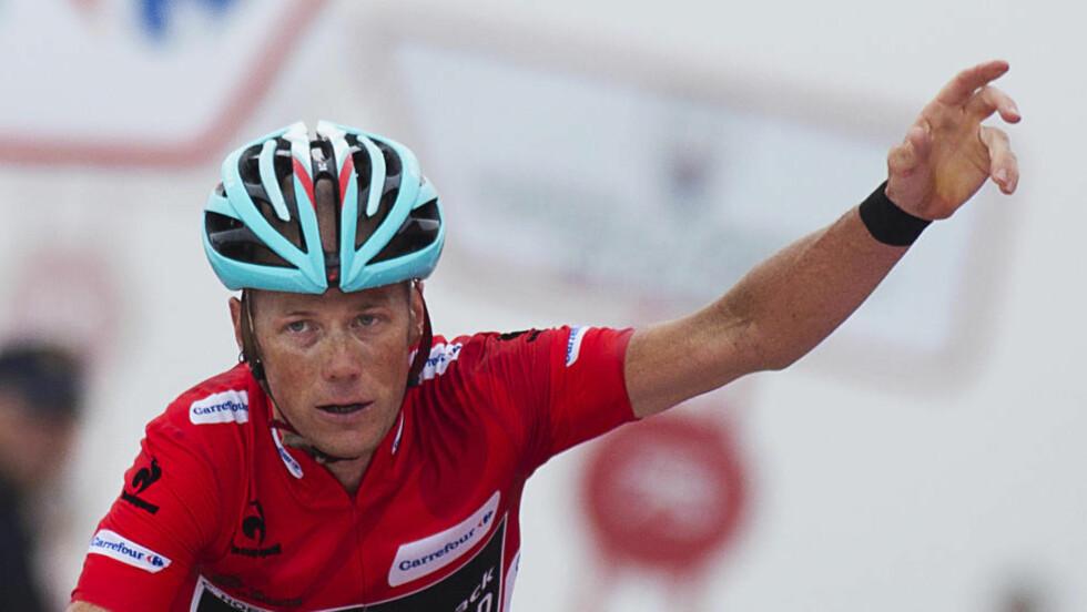 ARBEIDSLEDIG: 14. september 2013 krysset Chris Horner målstreken med visshet om at han  kunne kontrollere inn sin største triumf i karrieren. I ettertid har superveteranen slitt.  AFP PHOTO / JAIME REINA