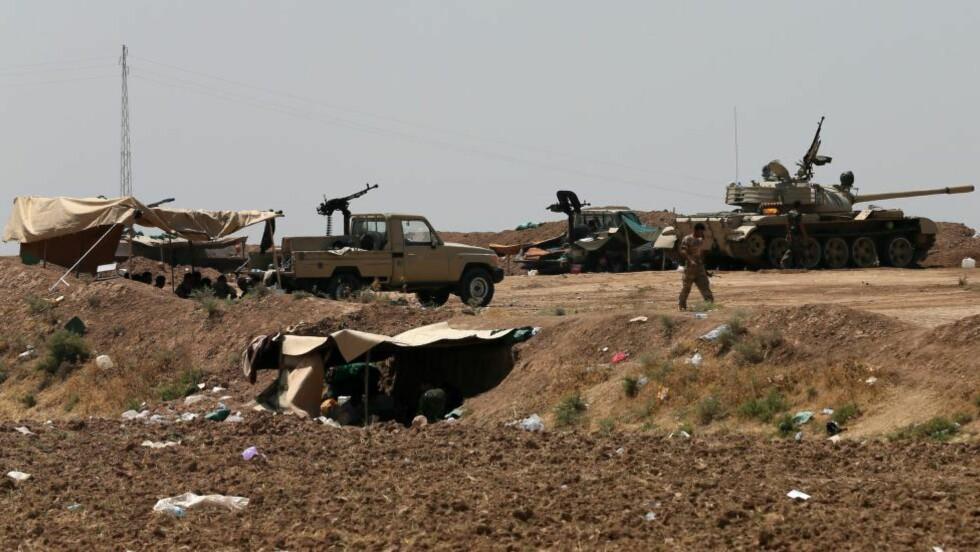 KAMP: Kurdiske styrker i nærheten av IS-kontrollerte Bashir, hvor IS blant annet har kontroll over store oljeressurser. Foto: AFP  / KARIM SAHIB / NTB scanpix