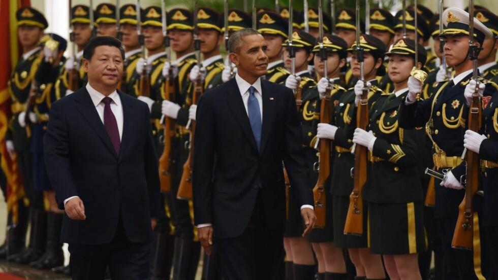 ENIGE: Kinas president, Xi Jinping, sammen med USAs president Barack Obama i Beijing. Foto: AFP PHOTO/Greg BAKER