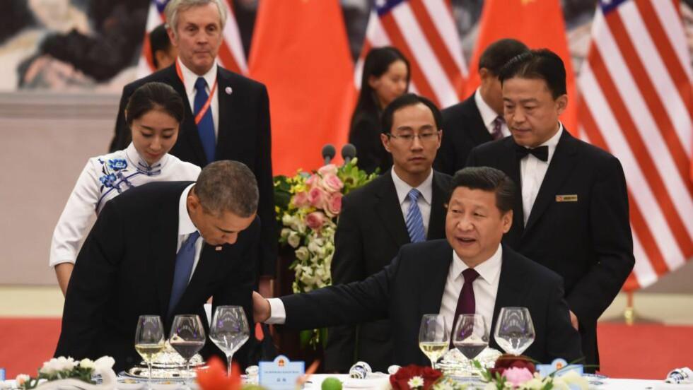 TRØBBEL PÅ HJEMMEBANE: Klimaavtalen mellom Kinas president Xi Jinping og USAs president Barack Obama mottas med lite begeistring blant Obamas politiske motstandere og kan lide en ublid skjebne. AFP PHOTO/POOL/Greg BAKER