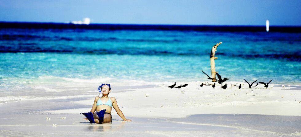 MALDIVENE: Turistenes Maldivene, med hvite strender, skyfri himmel og blått hav så langt øyet kan se, er et poulært reisemål for dem som vil dele ferien med venner i sosial medier. Foto: THOMAS RASMUS SKAUG