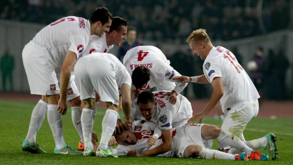 JUBEL: Polen har fått en drømmestart på EM-kvaliken og kunne juble etter seier mot Georgia i kveld. Foto:  EPA/ZURAB KURTSIKIDZE