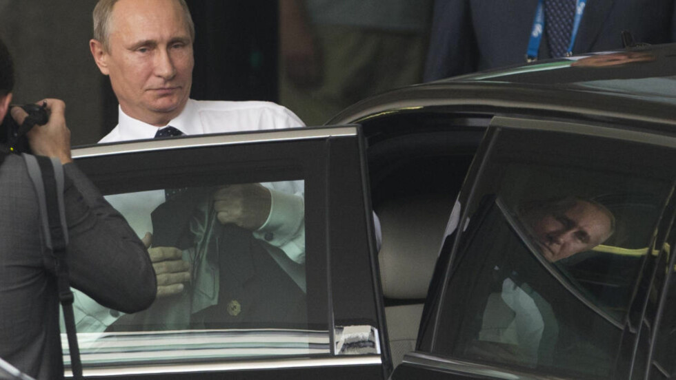 MÅTTE SOVE: Da Vladimir Putin forlot Brisband, sa han blant annet han ville reise seg tidlig for å få seg litt søvn på den lange flyturen til Russland. Foto: REUTERS/Jason Reed/NTB Scanpix