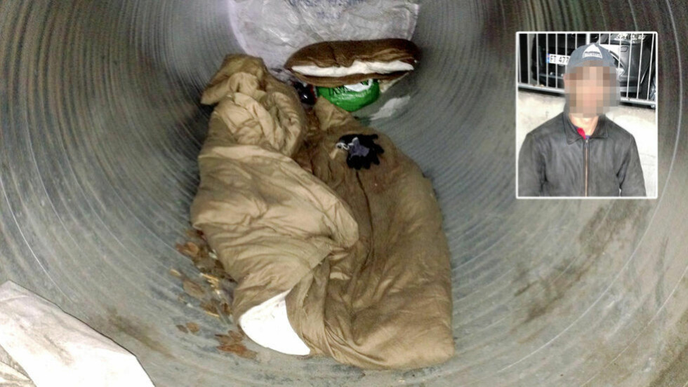 HER BODDE HAN:  I dette ventilasjonsrøret i garasjeanlegget Hamar-politiet benytter seg av, bodde rumeneren etter at han ble løslatt. Han skulle egentlig varetektsfengslet, men på grunn av celle-mangel måtte politiet la mannen i 20-åra gå. Foto: Politiet