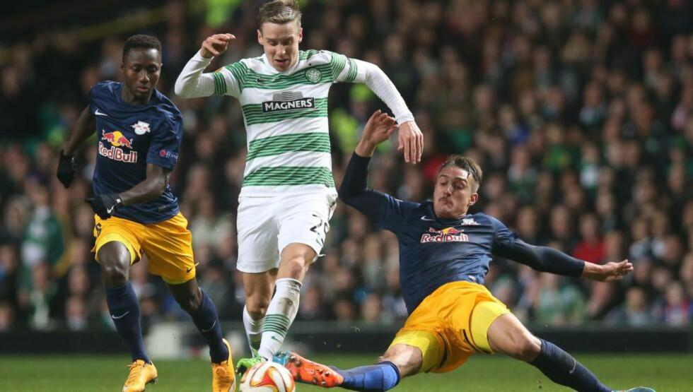 SCORET: Stefan Johansen scoret, løp og taklet, men det var ikke nok. Celtic tapte hjemme mot Red Bull Salzburg. AFP PHOTO / IAN MACNICOL