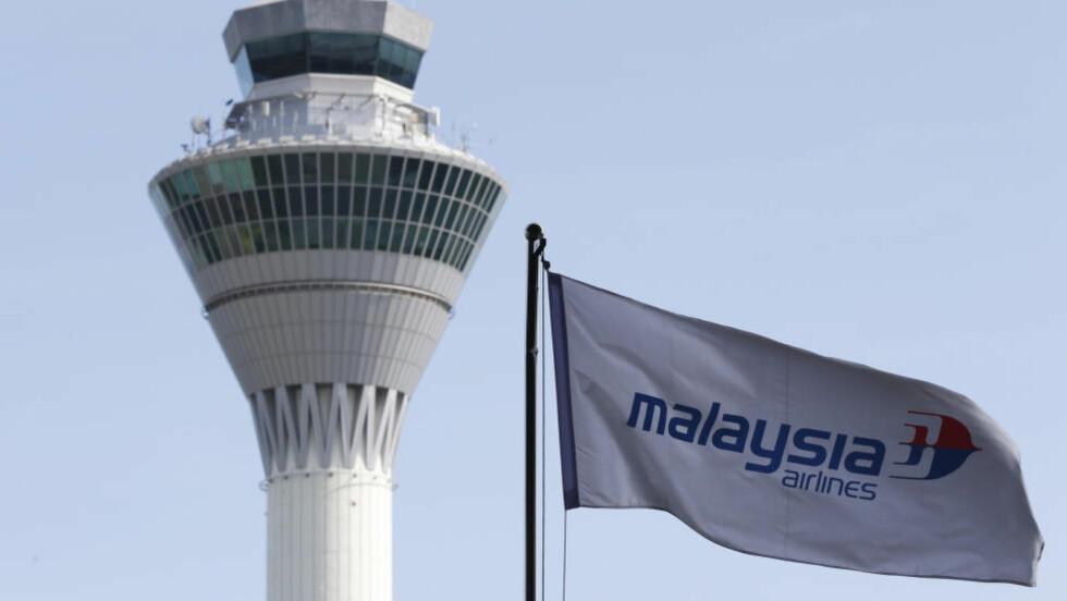 TABBET SEG UT: Flyselskapet Malaysia Airlines måtte lørdag beklage en reklamemelding, som kritikere mente hentydet til det savnede flyet MH370. Foto: Reuters / NTB scanpix
