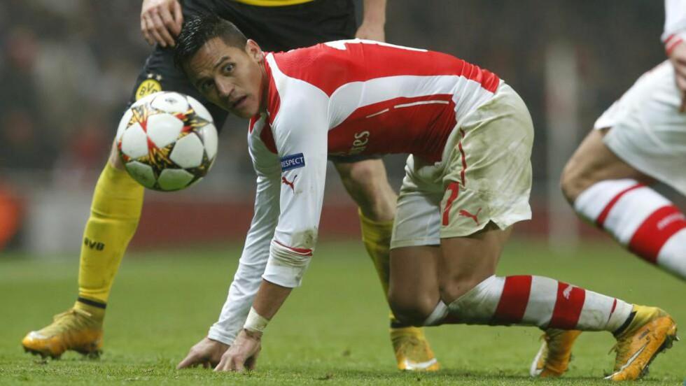 I SUPERFORM:Alexis Sanchez viser storform for Arsenal - men manager Arsene Wenger frykter juvelen kan bli slitt ut. Foto: AP Photo/Alastair Grant