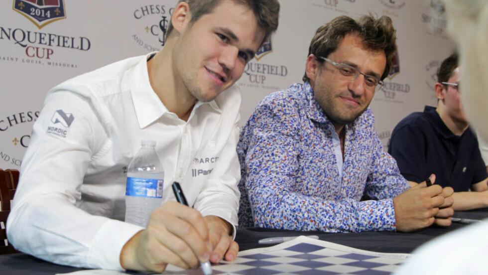 VIL HA ENDRING:  Grunnen til at Magnus Carlsen ikke vil skrive under på denne avtalen er at nordmannen ikke ønsker å spille tittelkampen mot Viswanathan Anand, som begynner om i overkant av to måneder, i den russiske OL-byen Sotsji. FOTO: AP.