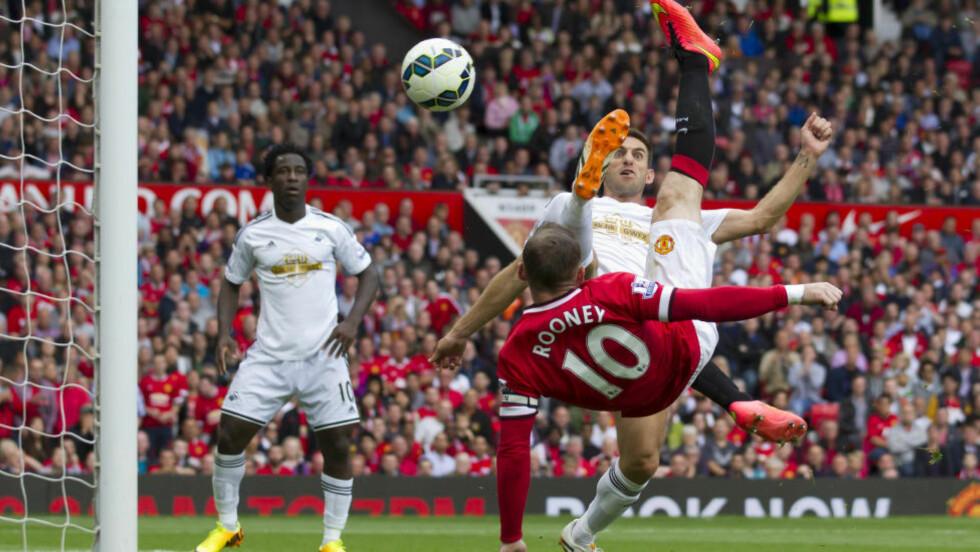 SCORER PÅ TWITTER. Manchester United og Wayne Rooney topper på det sosiale nettstedet Twitter. Klubben omtales mest i Premier League og Rooeny har flest følgere. Foto: AP.