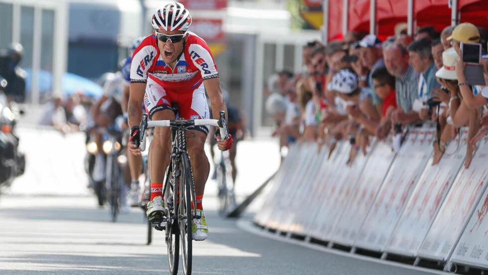 DOPET? Klassikerspesialisten Aleksandr Kolobnev er én av mange Katjusja-ryttere som skal ha vært klient hos den samme legen som hjalp Lance Arsmtrong med doping. Foto:  AFP PHOTO / BELGA / BRUNO FAHY