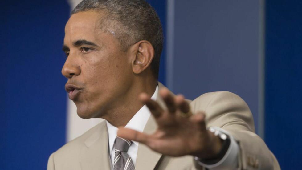 IKKE BEKYMRET: USAs president Barack Obama mener han har den nødvendige kontrollen for å holde verden i sjakk.Foto: EPA/MICHAEL REYNOLDS/NTB Scanpix
