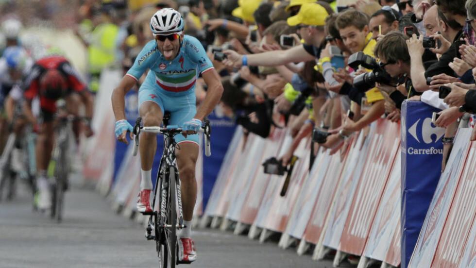ASTANA: Og Vincenzo Nibali får fortsatt lov til å kjøre Tour de France og andre toppløp neste år med ny lisens for 2015. (FOTO:REUTERS/Jacky Naegelen)
