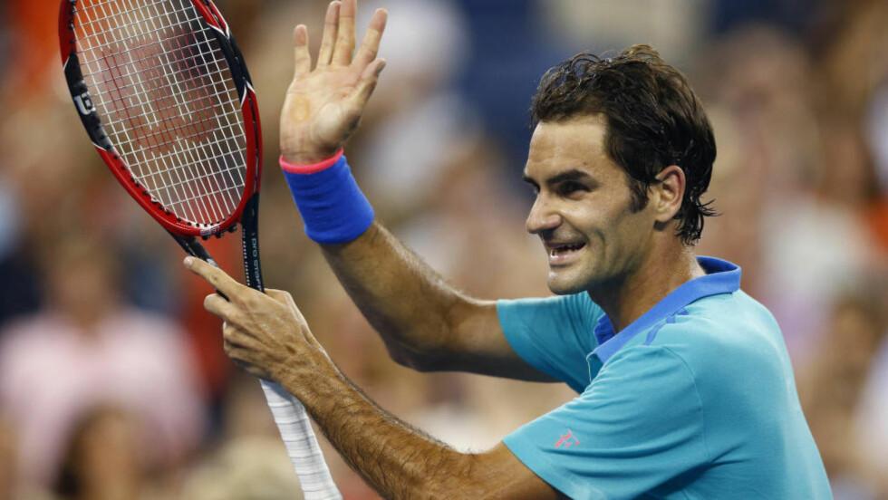 GREIT VIDERE: Roger Federer hadde startvansker mot spanske Marcel Granollers, men gikk til slutt enkelt videre til 4. runde i US Open. Foto: Adam Hunger / Reuters / NTB Scanpix
