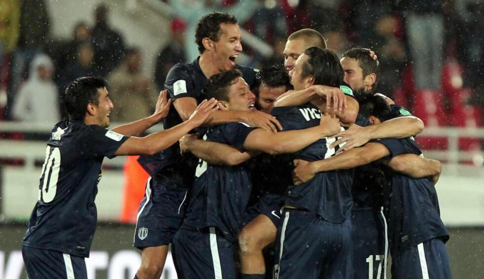 VM-SJOKK: Så glade ble Auckland Citys spillere etter at de slo afrikanske Setif. Foto: NTB Scanpix