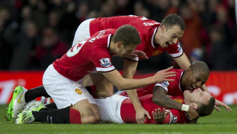 TOK FØRSTE STIKK: Wayne Rooney sendte Manchester United i ledelsen etter et praktfullt angrep. Da tok det av på Old Trafford. AP Photo/Jon Super)