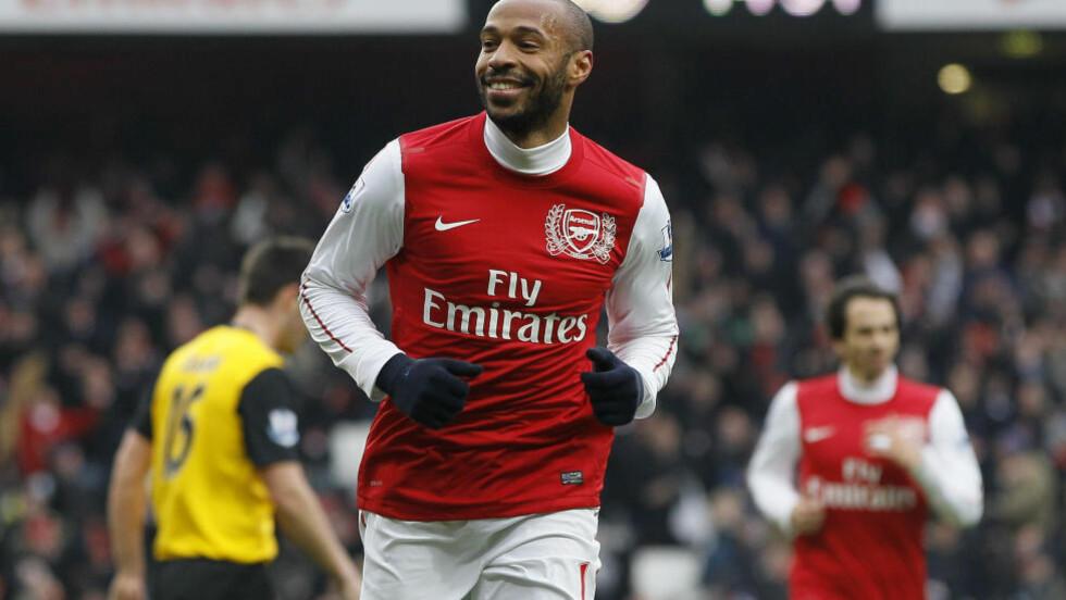 TAKKER AV: Thierry Henry forteller mandag morgen at han legger fotballskoene på hylla for godt. Foto: AP Photo/Kirsty Wigglesworth/NTB Scanpix