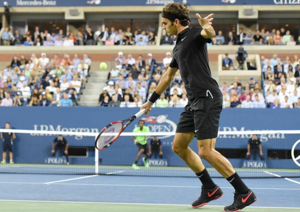 REISTE SEG MESTERLIG: Roger Federer viste at han fremdeles holder et skyhøyt nivå i kampen mot Gaël Monflis.. AFP PHOTO/Don Emmert