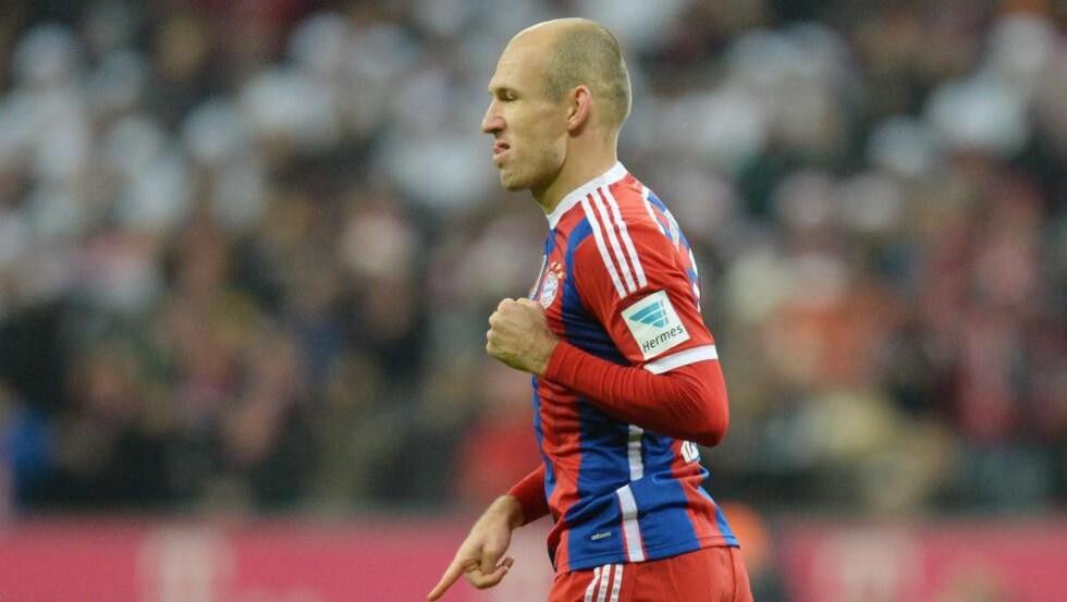 SCORET: Arjen Robben scoret Bayerns første mål.  AFP PHOTO / CHRISTOF STACHE