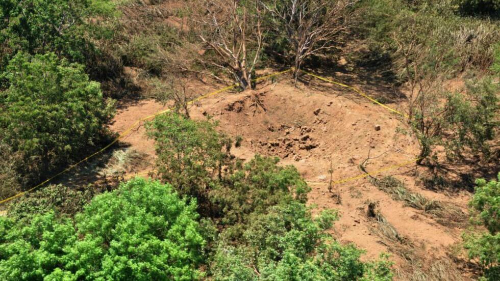 NICARAGUA:  Eksplosjonen skjedde i et skogsområde nær den internasjonale flyplassen i utkanten av byen og etterlot seg et 12 meter bredt krater. Foto: AP / NTB Scanpix.