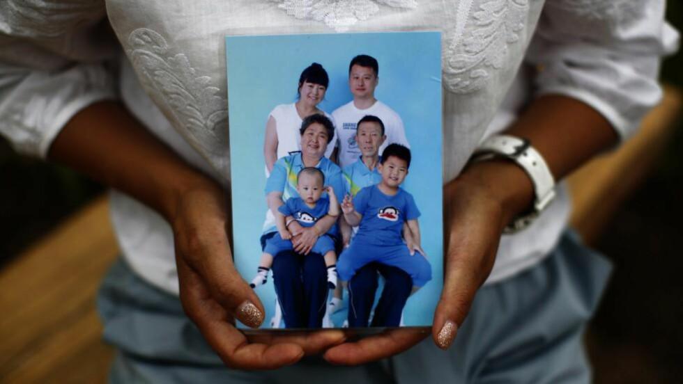 MISTET EKTEMANNEN: Cheng Lipings ektemann var om bord i flyet som forsvant. Foto: REUTERS / Kim Kyung-Hoon / NTB scanpix